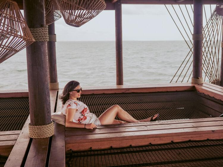 Kat relaxing at the Big Dock Bar over the water