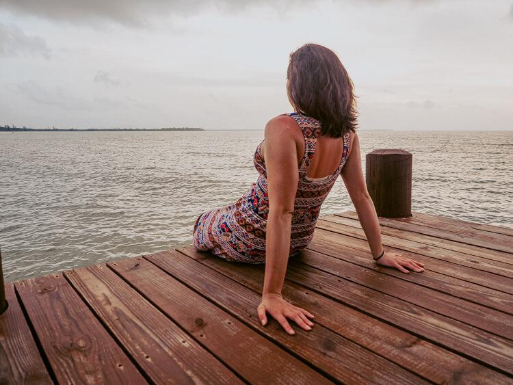 Kat sitting on the dock at Hopkins Bay Resort