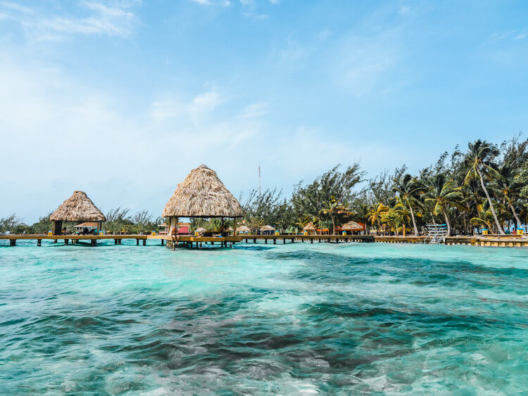 Ultimate Belize Honeymoon - Clear Caribbean water and docks over the water